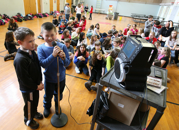 """Gloucester: Quinten Ulrich and Zach Abbott sing """"Poker Face"""" by Lady Gaga during an after school program at Plum Cove Elementary School on Tuesday. Abbott says he really likes Lady Gaga's songs. Photo by Kate Glass/Gloucester Daily Times"""