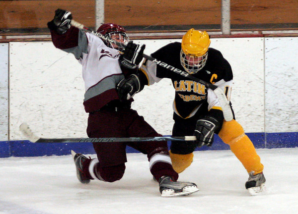 Gloucester: Rockport's Tucker Reedy and Boston Latin Academy's Tom Hynes get tangled up as they go for the puck at the Dorothy Talbot Rink yesterday. Photo by Kate Glass/Gloucester Daily Times