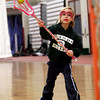 Gloucester: Sylvie Oldman of Manchester works on shooting during a Cape Ann Youth Lacrosse clinic for girls under age 9 at Gloucester High School on Sunday. Photo by Kate Glass/Gloucester Daily Times
