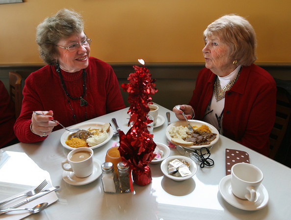 Rockport: Linda Hogan and Anne Marie Frisone enjoy lunch at Bracketts Oceanview Restaurant yesterday during the Rockport Rotary Club's Annual Valentine Luncheon for senior citizens. Photo by Kate Glass/Gloucester Daily Times