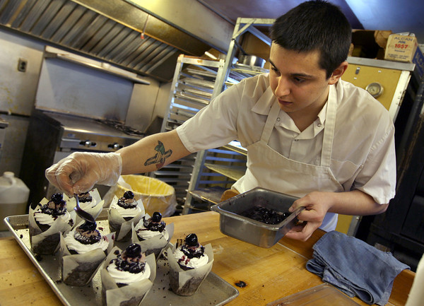 Rockport: Ross Brackett places cherries on top of black forest cupcakes at Brothers Brew in Rockport. Ross and his brother, Marc, recently opened in the former location of The Coffee Shop. Photo by Kate Glass/Gloucester Daily Times
