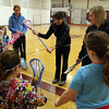 Gloucester: Sarah Holch of Manchester Essex, Sarah Powers of Pingree Academy, and Amanda Barker of Gloucester demonstrate why it is important to keep two hands on the stick during a Cape Ann Youth Lacrosse clinic for girls under age 9 at Gloucester High School on Sunday. There will be a clinic for boys next Sunday. Photo by Kate Glass/Gloucester Daily Times