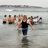 Gloucester: J.T. Turner makes his way out of the fridgid waters during the Rotary Club's Polar Plunge to eradicate Polio at Long Beach Saturday morning.  About 40 swimmers took part in the swim and members from 17 differnt local rotaries showed up in support of the cause. Mary Muckenhoupt/Gloucester Daily Times