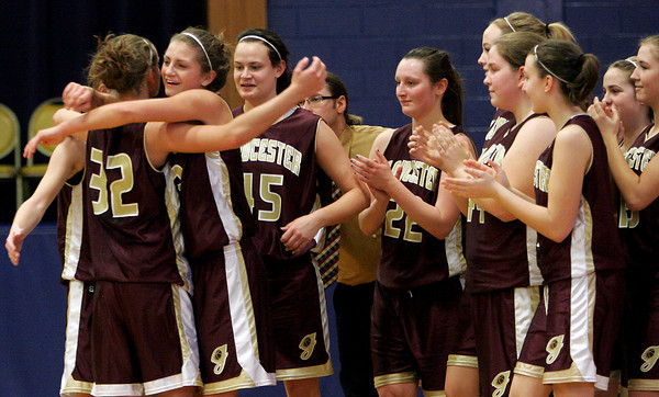 Lynn: Heather Cain hugs her sister, Hannah (32), after Hannah scored her 1,000th career point during Gloucester's game against Tewksbury at St. Mary's High School in Lynn yesterday. Photo by Kate Glass/Gloucester Daily Times