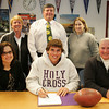 Gloucester: Gloucester senior Andrew Mizzoni signs his letter on intent for Holy Cross College along with his parents Annmarie, left, and Steven, right, and Althletic Director Kim Patience, Gloucester High School principal William Goodwin and guidance counselor Laura Carlson, right at Gloucester High School Friday afternoon. Mary Muckenhoupt/Gloucester Daily Times