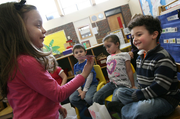 """Gloucester: Allie Valvano gives a valentine to her classmate, Isaiah Francis, during a """"Friendship Day"""" celebration at the Gloucester Preschool at Fuller School yesterday. Photo by Kate Glass/Gloucester Daily Times"""