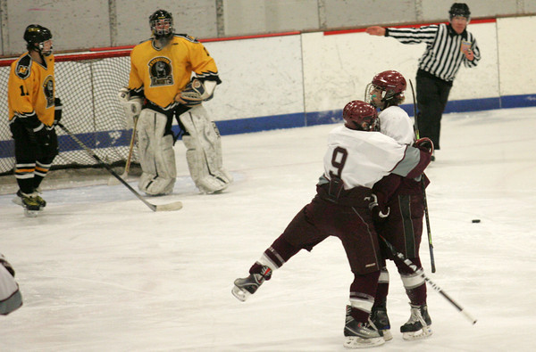 Rockport: Jonathan Ferrante hugs teammate Cam Smith after Smith scored a goal for the Vikings during the Rockport vs. Northeast Metro hockey game at Talbot Rink Wednesday night. Mary Muckenhoupt/Gloucester Daily Times