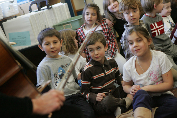 Gloucester: First grade students, including fro left, Ryan Carpenter, Robert Schuster, Jacob Andrews, back, and Hannah Fletch listen to Sandy Kiefer's Talking Cello program at East Gloucester Elementary School Friday morning. Kiefer came to the school to tell stories with sound effects from her cello like a meowing cat, blowing wind, heavy foot steps and much more. The program was sponsored by the school's PTO. Mary Muckenhoupt/Gloucester Daily Times