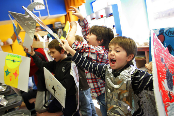 Gloucester: Shea Verga, 6, show off his armor with his friends during Lord of the Rings day at Cape Ann Art Haven Wednesday morning. the kids spents the morning making armor befire watching Lord of the Rings in the afternoon. Also pictured is Henry Jaques, left of Verga. Mary Muckenhoupt/Gloucester Daily Times