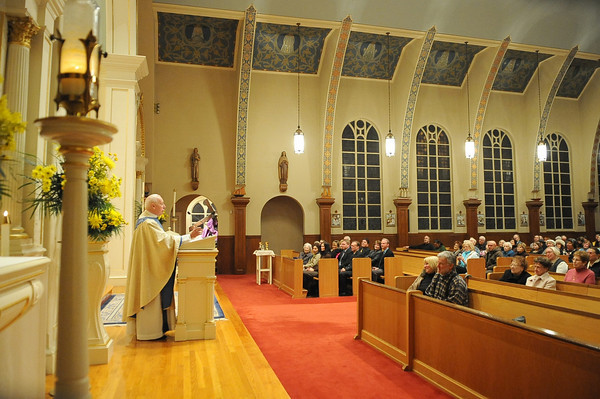 Gloucester: Father Alves recalls his beginings at Our Lady of Good Voyage during Wednesday nights service. Desi Smith/Gloucester daily Times. January 2,2011.