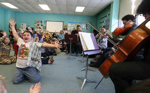 Rockport: Sam MacDowell dances as the Harlem Quartet performs for Rockport Elementary School students yesterday afternoon as part of their 4-day residency on the North Shore with Rockport Music's education programming. The Quartet will be giving a free concert at the Shalin Liu Performance Center for the community tonight at 7 pm. Photo by Kate Glass/Gloucester Daily Times