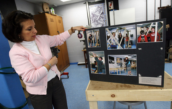 Gloucester: O'Maley Middle School Principal Deborah Lucey looks through pictures of students building bridges in the school's science center, which was funded through a grant from MIT. Photo by Kate Glass/Gloucester Daily Times