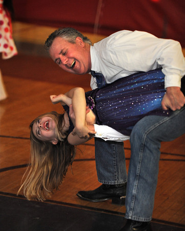 """Gloucester: Peter Marshall dips his daughter Lily 7, as they dance to the music by DJ Tony """"D"""" Saturday night at the YMCA's Father Daughter Dance. This is Marshall's and his daughter's 3rd year attending.Desi Smith/Gloucester Daily Times. February 12,2011."""