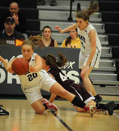 Manchester: Manchester's Abbi Bigger passes the ball after winning the battle for a loose ball against Newbury last night at MERHS. Desi Smith/Gloucester Daily Times. February 13,2011.