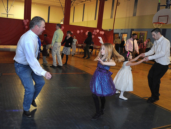 """Gloucester: Peter Marshall and his daughter Lily 7, (left) and Jimmy Militello with his daughter Bailee 5, dance to the music by DJ Tony """"D"""" Saturday night at the YMCA's Father Daughter Dance. Desi Smith/Gloucester Daily Times. February 12,2011."""