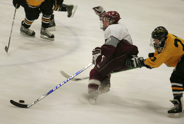 Rockport: Rockport's Brendan Surette keeps the puck ahead of Northeast Metro defenders including Tyler Accolla, right, duirng the hockey game at Talbot Rink Wednesday night. Mary Muckenhoupt/Gloucester Daily Times