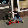 Rockport: (SPELLED CORRECTLY) Seanadam Baskett, 2, enjoys the warm weather by riding on his scooter in downtown Rockport Thursday afternoon.  Seanadam was with his grandmother who was trying to wear him out so he would take a nap and recharge before a ski lesson he was going to later that day.  Mary Muckenhoupt/Gloucester Daily Times