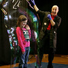 Gloucester: Maya Cormier, a second grader at West Parish Elementary School, waves to the corwd as Casey Carle puts her in a giant bubble during the finale of his program Bubble Mania in the school's auditorium Thursday afternoon. Mary Muckenhoupt/Gloucester Daily Times