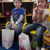 Gloucester: Lorenzo Numerosi looks over as Isabelle Lapa examines a valentine she received from one of her classmates at the Gloucester Preschool at Fuller School yesterday. The students decorated bags to keep their valentines and brought in valentines for all of their classmates. Photo by Kate Glass/Gloucester Daily Times