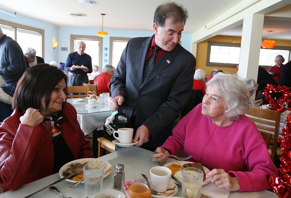 Rockport: Rockport Rotary President Bob Visnick serves coffee to Minerva Montano, left, and Kay Murphy, right, at Bracketts Oceanview Restaurant yesterday during the Rockport Rotary Club's Annual Valentine Luncheon for senior citizens. Photo by Kate Glass/Gloucester Daily Times
