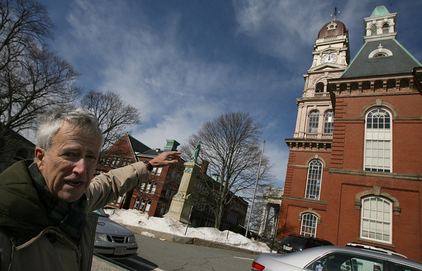 Gloucester: J.J. Bell, Co-Chair of the Community Preservation Committee, points to several elements of City Hall that will be renovated using funds generated through the Community Preservation Act. Primary features that will be renovated include the clock tower, ventilators, eaves, windows and entrances. Photo by Kate Glass/Gloucester Daily Times