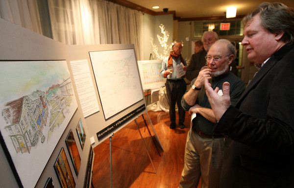 Gloucester: Peter Van Ness discusses his I-4, C-2 proposal, Heart of the Harbour, with Paul Stetzer during the seARTS Annual Meeting at Cruiseport last night. Photo by Kate Glass/Gloucester Daily Times
