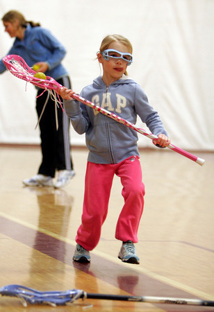 Gloucester: Gracie Susko of Manchester focuses on the net during a Cape Ann Youth Lacrosse clinic for girls under age 9 at Gloucester High School on Sunday. Photo by Kate Glass/Gloucester Daily Times