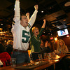 Gloucester: Mike Vien and Colleen VonHaden cheer as the Green Bay Packers score a touchdown during the Super Bowl last night. With them at Minglewood Tavern are Emily Vien, left, Brian Renaud and Leslie Alexis. Photo by Kate Glass/Gloucester Daily Times
