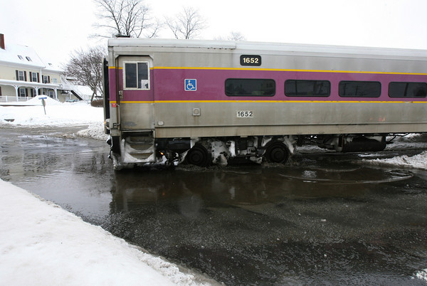 Gloucester: A train crosses Washington Street and heads in to the train station Wednesday afternoon. Kate Glass/Gloucester Daily Times