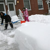Gloucester: Sooae Ono and Samantha Sullivan shovel the walkway along Maplewood Avenue yesterday afternoon. The snow had piled up in the middle from a couple storms and they wanted to get rid of it. Photo by Kate Glass/Gloucester Daily Times