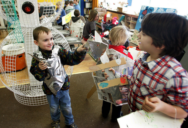 Gloucester: Owen Casey, 5, battles with Henry Jaques, 8, during Lord of the Rings day at Cape Ann Art Haven Wednesday monring. The kids at Art Haven had built their sheilds and weapons out of cardboard, while their armor was made from aluminum baking pans and the capes were made from back issues of the Gloucester Daily Times. Mary Muckenhoupt/Gloucester Daily Times