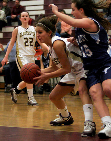 Gloucester's Heather Cain dribbles around Peabody's Jackie Goodwin during their game at the Benjamin A. Smith Fieldhouse last night. Photo by Kate Glass/Gloucester Daily Times