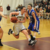Gloucester:   Gloucester's Audrey Knowlton drives to the basket between two Danvers players last night at the Benjamin A Smith Feildhouse. Desi Smith/Gloucester Daily Times. February 18,2010.