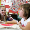 Gloucester: Gloucester High School senior Alex Levie talks with about how to become environmentlally friendly Briana Bruni in Brian MacCorkle's forth grade class at Beeman Elementary School Thursday afternoon.  The program, which is a collaborative effort between Gloucester High school and the Cape Ann Moose Lodge, consists of eight students who speak to elementary school students about such topics as becoming well rounded and developing good habits. The presenters are attempting to qualify for scholarships offered by the International Moose Organization. Mary Muckenhoupt/Gloucester Daily Times