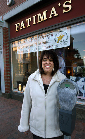 Gloucester: Shelly Gossom, a hairdresser at Fatima's Hair Design on Main Street, has collected over 170 signatures on a petition encouraging the city council to revisit the new ordinance regarding parking on Main Street. Gossom says one of her clients, who is elderly, has already been issued two tickets for going over the 2-hour limit at meters, but her hair treatments last over two hours. Photo by Kate Glass/Gloucester Daily Times