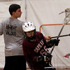 Gloucester: Kyle Frost spins around Joey Falzarano during an offense drill at the Cape Ann Youth Lacrosse Clinic at Gloucester High School on Sunday morning. Photo by Kate Glass/Gloucester Daily Times