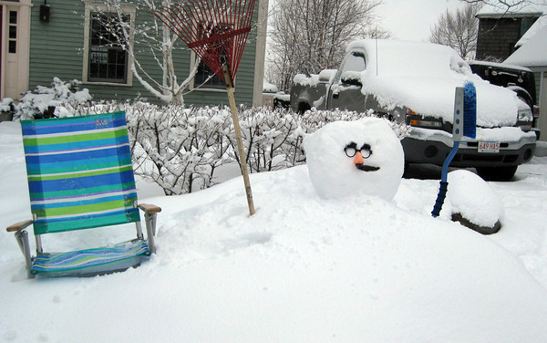 Rockport: The Boucher family pokes a little fun at yet another storm this winter with a snow sculpture in their yard on Twin Light Circle and looks forward to really being able to use the beach chair again. Photo by Gail McCarthy/Gloucester Daily Times