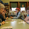 Manchester: Pat Fairhurst teaches Mary Rerisi, Toni Rerisi, and Lea Sutherland how to play cribbage at the Manchester Public Library yesterday afternoon. Photo by Kate Glass/Gloucester Daily Times