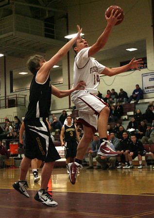 Gloucester: Jordan Shairs leaps for a layup during their game against Bishop Fenwick at the Benjamin A. Smith Fieldhouse last night. Photo by Kate Glass/Gloucester Daily Times