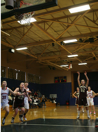 Lynn: Gloucester's Hannah Cain watches as her second free throw sinks in the net for her 1,000th career point during their game against Tewksbury at St. Mary's High School in Lynn yesterday. Photo by Kate Glass/Gloucester Daily Times