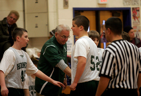 Essex: Hardy Nalley gathers the Manchester Essex 8th grade boys basketball team before their game against Rockport at Essex Elementary School yesterday. Photo by Kate Glass/Gloucester Daily Times