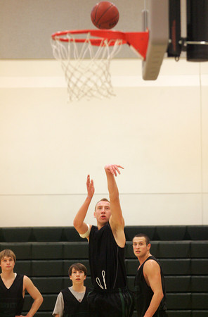 Manchester:  Joseph Mussachia shoots the ball while running drills during basketball practice at Manchester Essex High School Friday afternoon. Also pictured, from left, Sean Nally, Liam Aldrich and Adam Jackson. Mary Muckenhoupt/Gloucester Daily Times