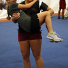 "Gloucester: GHS cheerleader Erica Quince picks up her cousin, Sabrina Quince, while playing ""Chicken in the Hen House"" at GHS Cheerleading Mini Camp on Tuesday. Photo by Kate Glass/Gloucester Daily Times"