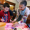 "Manchester: Stella Nahatis helps her grandson, Trey Danehy, make a valentine for his grandfather, ""Papou,"" at the Manchester Library on Wednesday. Trey says it will be the best valentine his Papou has ever seen. Photo by Kate Glass/Gloucester Daily Times"