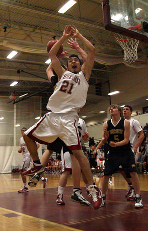 Gloucester: Gabe Munoz loses control of the ball during their game against Bishop Fenwick at the Benjamin A. Smith Fieldhouse last night. Photo by Kate Glass/Gloucester Daily Times