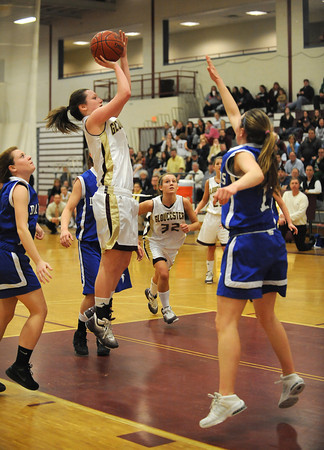 Gloucester:  Gloucester's Audrey Knowlton throws up a jumper against Danvers last night at the Benjamin A Smith Feildhouse. Desi Smith/Gloucester Daily Times. February 18,2010.