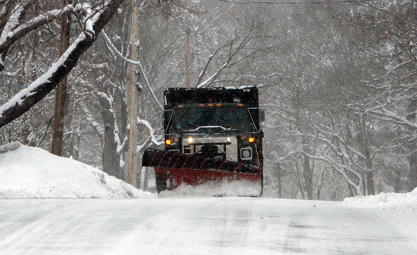 Gloucester: A snowplow scrapes packed snow off Magnolia Avenue yesterday afternoon. Photo by Kate Glass/Gloucester Daily Times