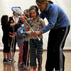 Gloucester: Coach Sarah Holch gives some pointers to Augusta Taylor of Manchester during a shooting drill at the Cape Ann Youth Lacrosse clinic for girls under age 9 at Gloucester High School on Sunday. Photo by Kate Glass/Gloucester Daily Times