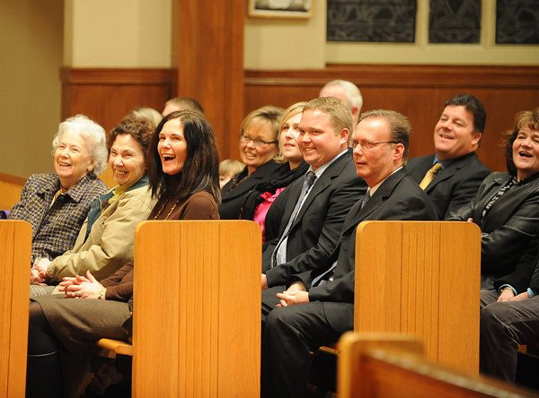 Gloucester: Family members break out with laughter as Father Alves recalls his beginings at Our Lady of Good Voyage Wednesday night. Desi Smith/Gloucester daily Times. January 2,2011.