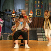 "Gloucester: Danielle Crear as Madame Grande Bouche, Tess Benson as Lumiere, and Jemma Johnson-Shoucair as Cogsworth attempt to welcome Aaron Graham as Maurice during a scene from O'Maley Middle School's production of ""Beauty and the Beast,"" which runs Friday, March 4 and 11 at 7pm and Saturday, March 5 and 12 at 1pm. Photo by Kate Glass/Gloucester Daily Times"